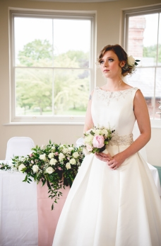 Bride with bouquet, posed